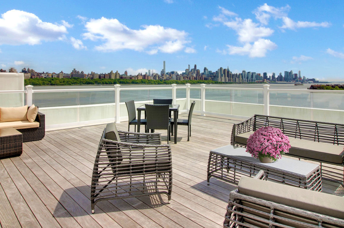 The furnished Skydeck is a 200-foot long roofdeck with views of NYC & Hudson River