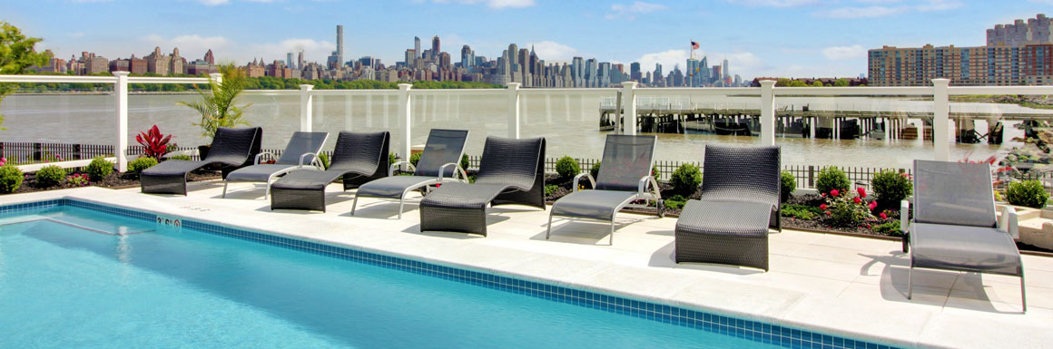 The pool has an perfect view of the river and New York City.