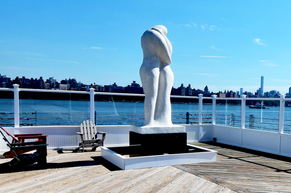 Statue of couple embracing on the Oyster's private pier
