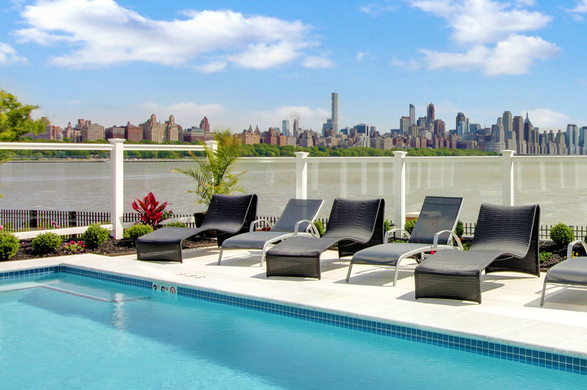 Beautiful landscaped outdoor pool with river & Manhattan views