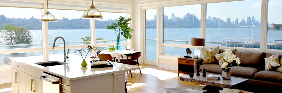 Stunning views of NYC & Hudson River from living room floor-to-ceiling windows